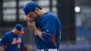 Ike Davis looks on during spring training practice