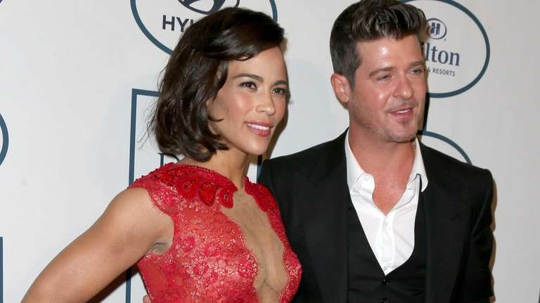 Paula Patton and Robin Thicke attend the re-GRAMMY