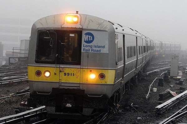 A train enters foggy Jamaica station as LIRR