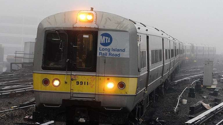 A train enters foggy Jamaica station as LIRR
