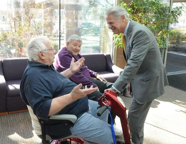 Congressman Steve Israel talks to seniors Anthony Ciuffo,