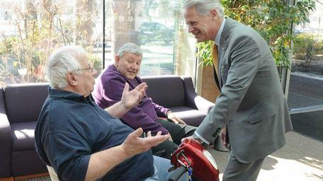 Congressman Steve Israel talks to seniors Anthony Ciuffo,