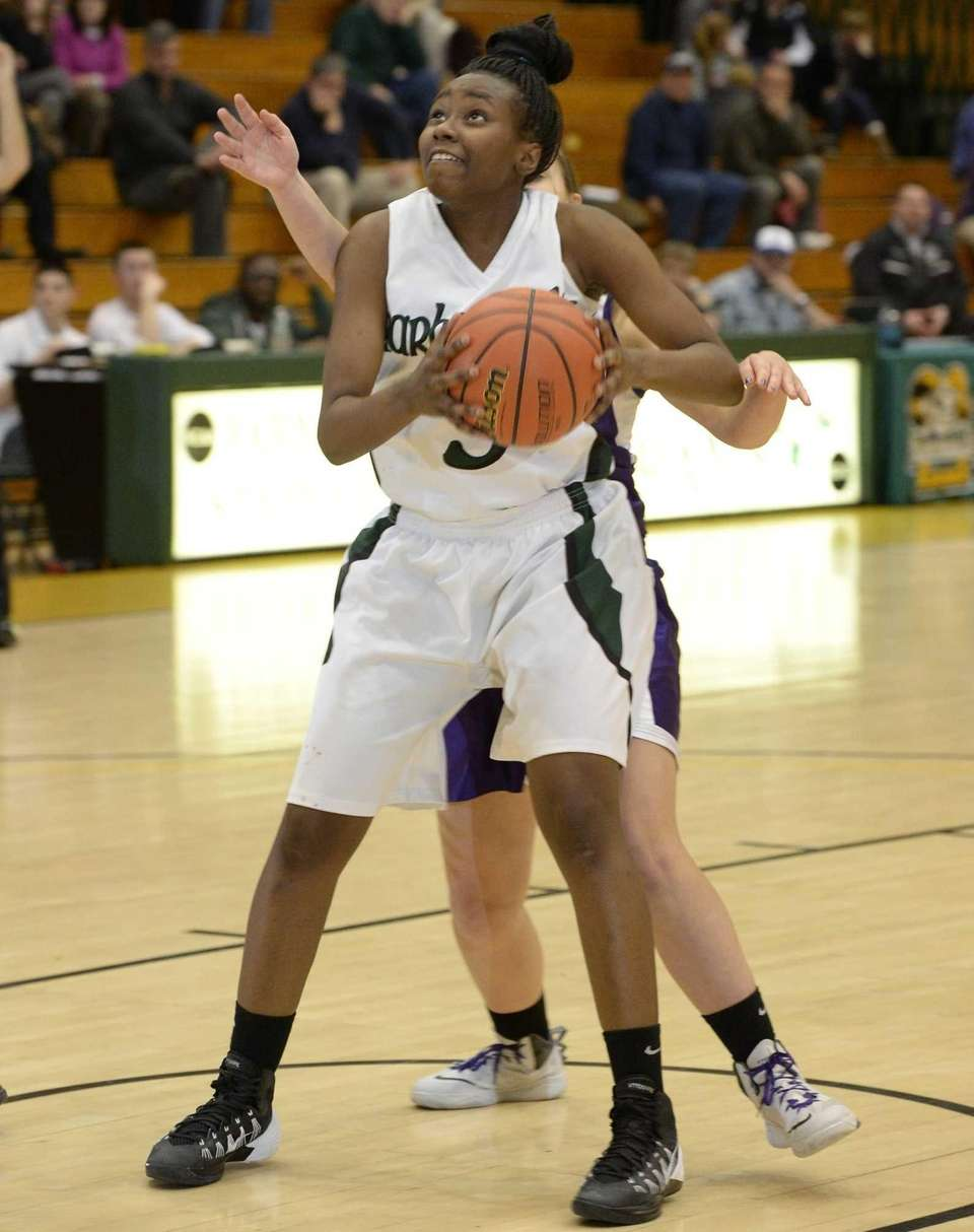 Harborfields' Donasja Scott moves to shoot from under