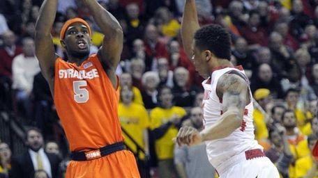 Syracuse forward C.J. Fair (5) shoots against Maryland