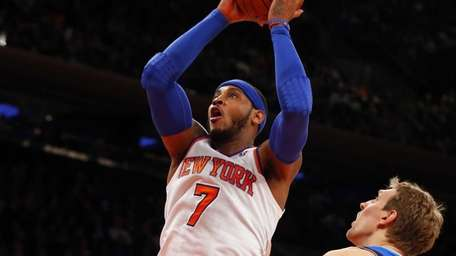 Carmelo Anthony goes to the hoop past Dirk