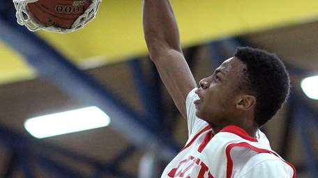 Valley Stream South's Hall Elisias dunks the ball