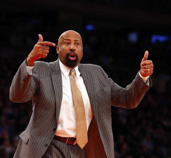 Mike Woodson reacts during the second half of