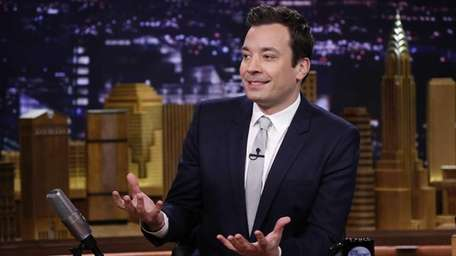 Host Jimmy Fallon is seated at his desk
