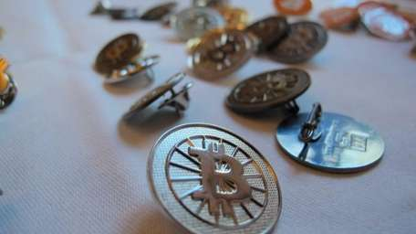 Bitcoin buttons displayed on a table at the