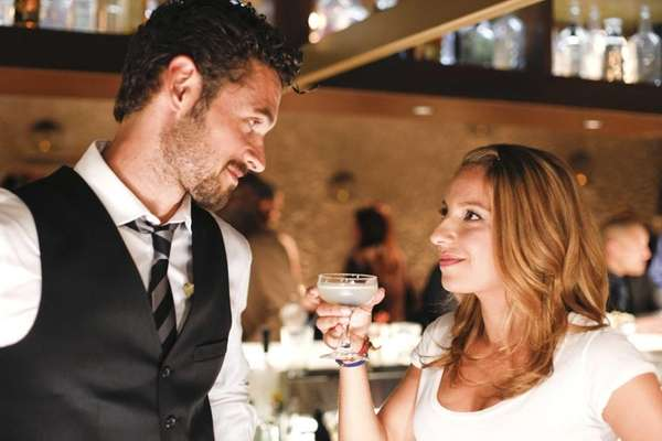 "Adan Canto and Vanessa Lengies in ""Mixology."""