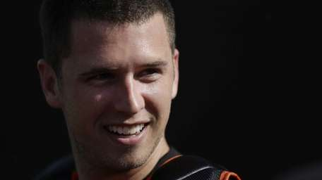 San Francisco Giants catcher Buster Posey attends spring