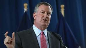 New York City Mayor Bill de Blasio holds