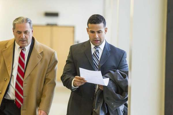 Defense attorney David Besso, left, and his client