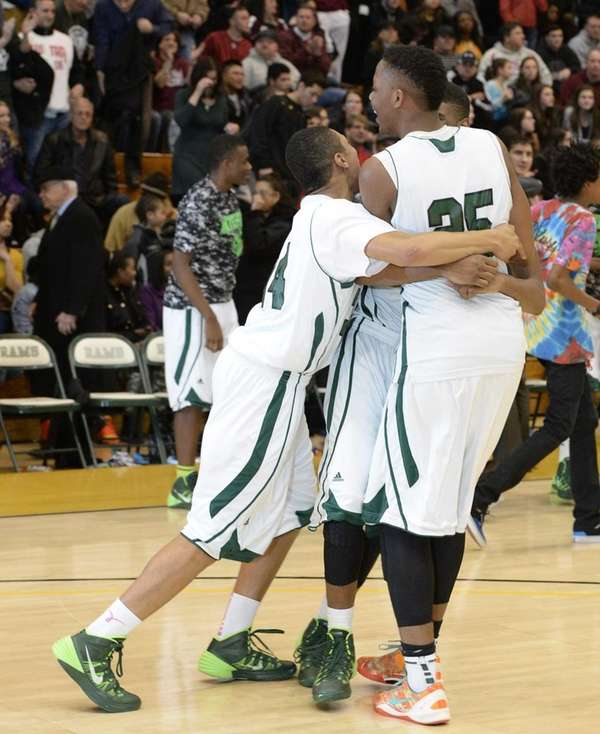 Brentwood forward/center Femi Olujobi, right, and teammates celebrate