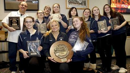 The St. Dominic girls bowling team celebrate with