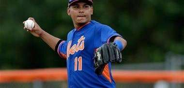 Ruben Tejada throws during spring training baseball practice