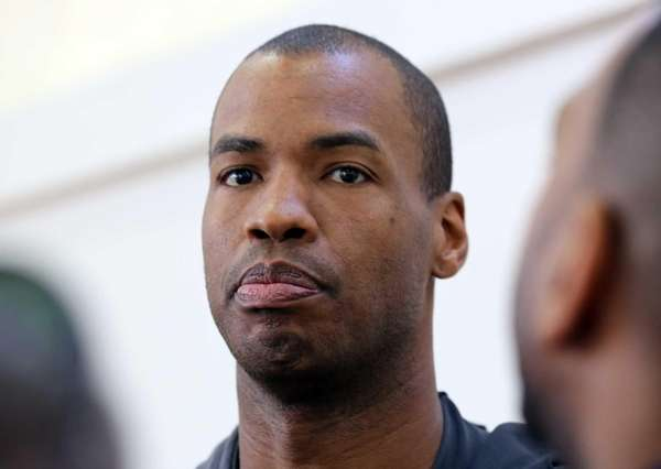 Jason Collins talks with reporters during practice on
