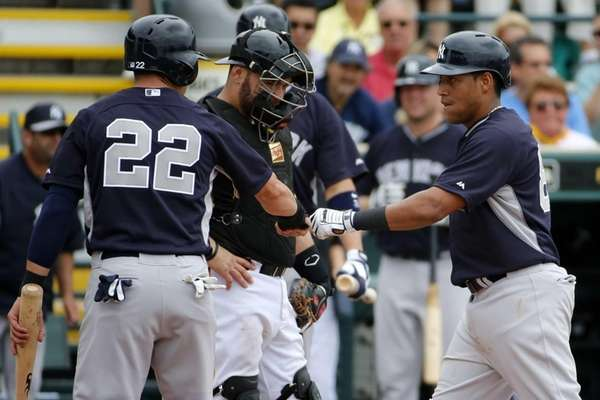 Ramon Flores, right, scores past Pittsburgh Pirates catcher