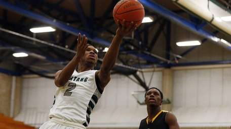 Tristan Brown of the Elmont Spartans goes to