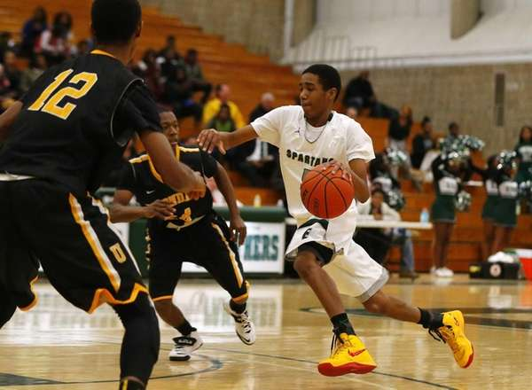 Matthew Graham of the Elmont Spartans drives to