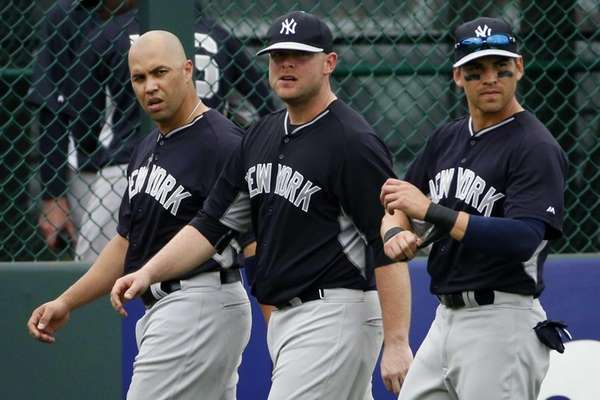 From left, Yankees' Carlos Beltran, Brian McCann, and