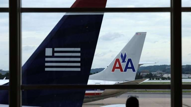 American Airlines and US Airways planes parked at