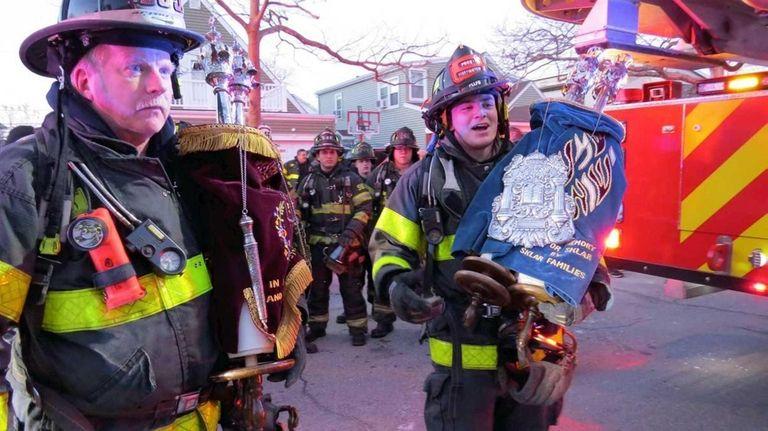 Long Beach Fire Department Lt. Billy Wade, left,