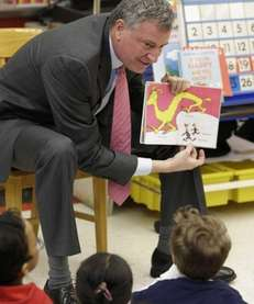 New York City Mayor Bill de Blasio reads