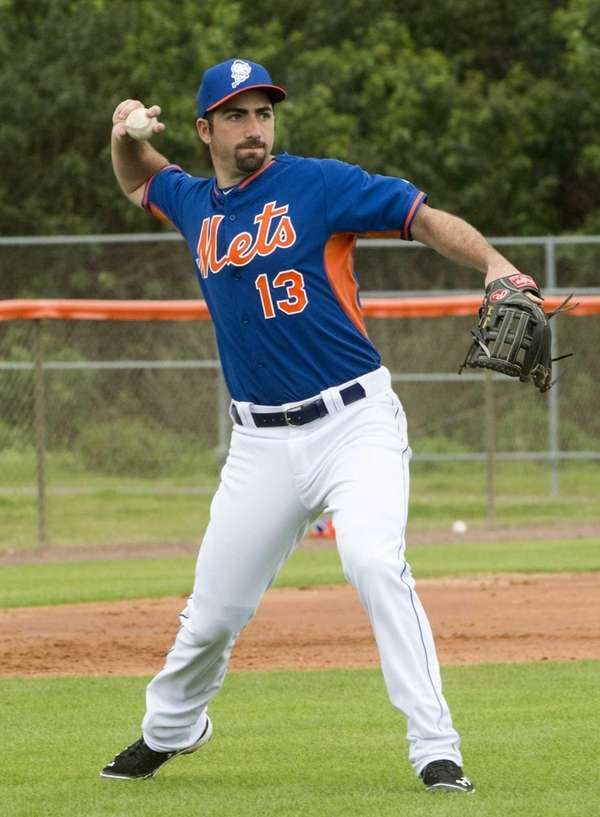 Josh Satin throws during spring training practice on