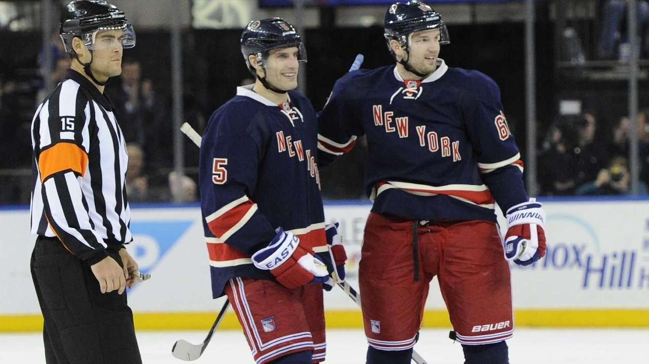 Rangers left wing Rick Nash, right, celebrates his