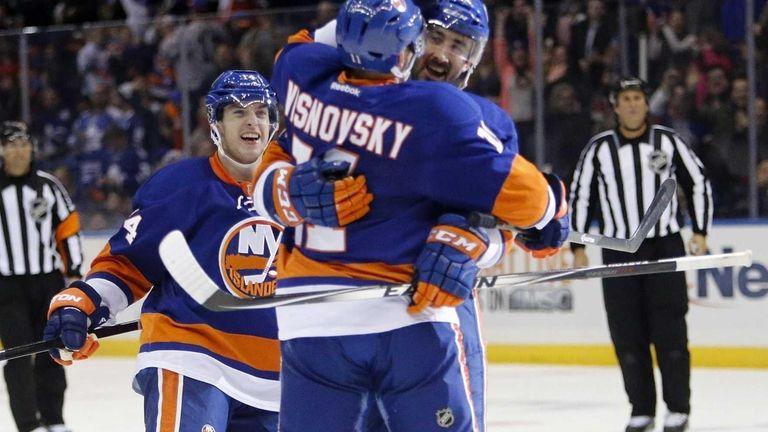 Islanders right wing Colin McDonald hugs Islanders defenseman