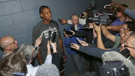 Nets center Jason Collins talks to reporters before