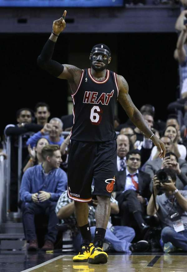 Miami Heat small forward LeBron James celebrates after