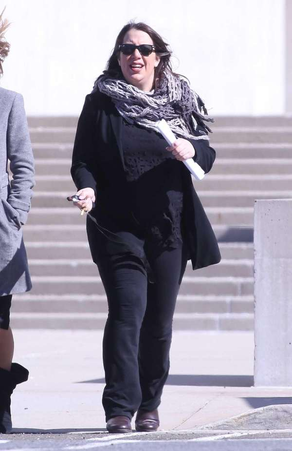 Laurie Schneider leaves federal court in Central Islip