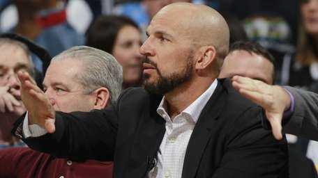 Jason Kidd directs his team against the Denver