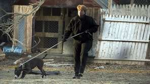 A Town of Hempstead animal control officer removes