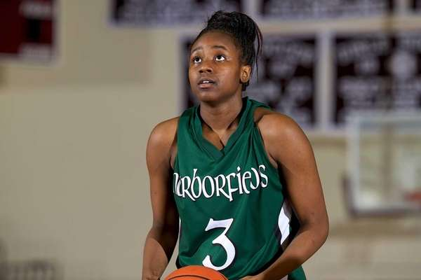 Harborfields forward Donasja Scott prepares to take a