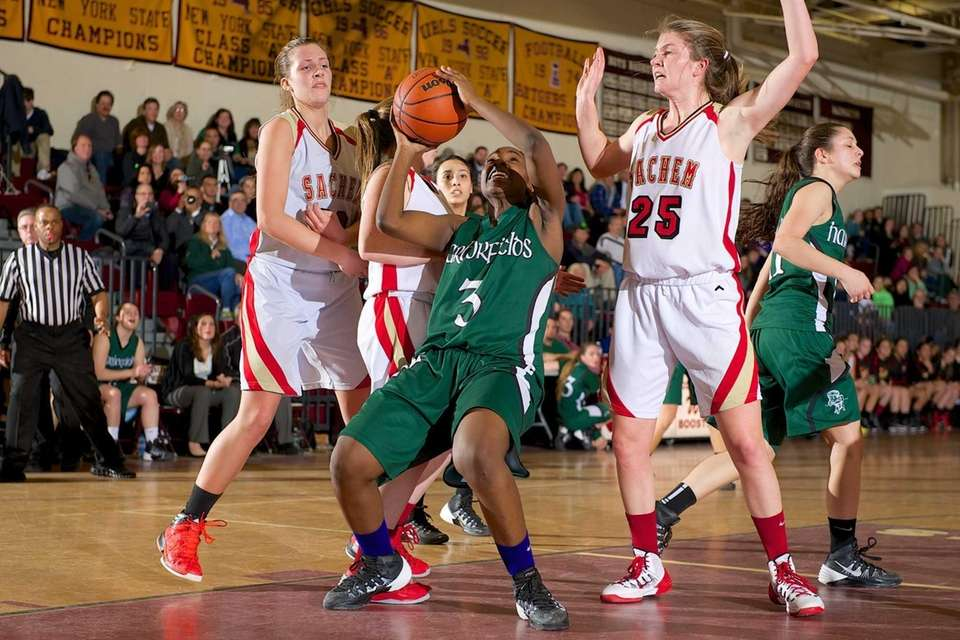 Harborfields forward Donasja Scott grabs a rebound against