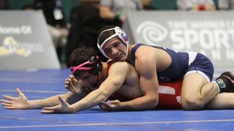 Zach Lugo of Deer Park goes against opponent