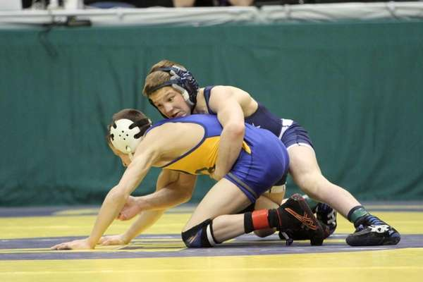 Adam Busiello of Eastport-South Manor goes after opponent