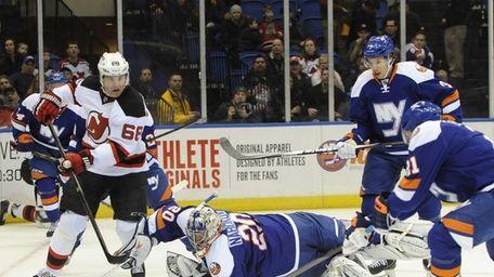 Islanders goalie Evgeni Nabokov falls to the ice