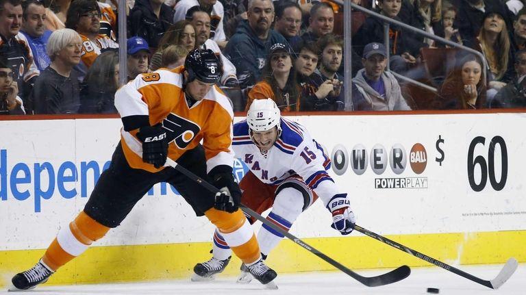 Philadelphia Flyers' Nicklas Grossmann, left, tries to keep