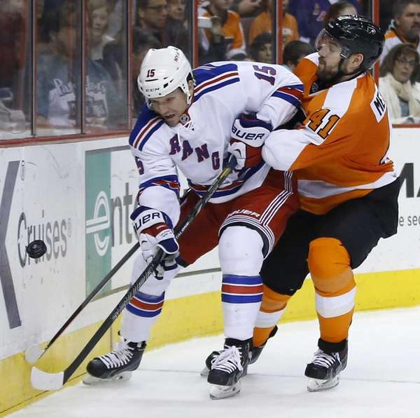 Derek Dorsett and Flyers' Andrej Meszaros battle for