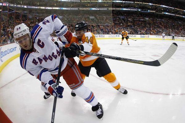 Flyers' Kimmo Timonen shoves Rangers' Ryan Callahan into