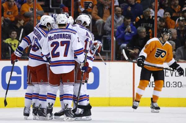 Rangers' Derick Brassard celebrates with teammates after scoring