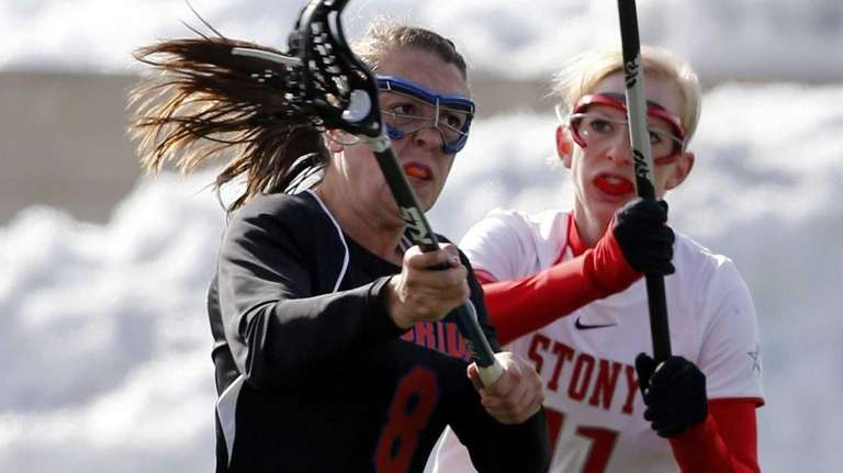 Florida's Shannon Gilroy shoots on goal while being