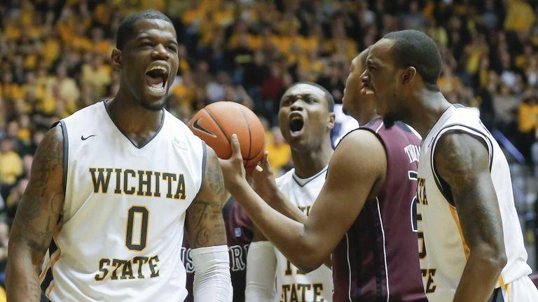 Wichita State's Chadrack Lufile celebrates getting fouled by