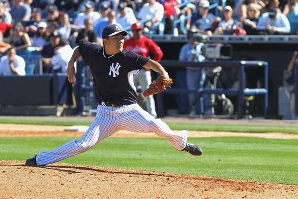 Masahiro Tanaka of the Yankees pitches against the