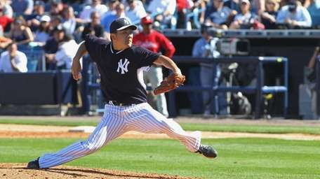 Masahiro Tanaka of the Yankees pitches against the