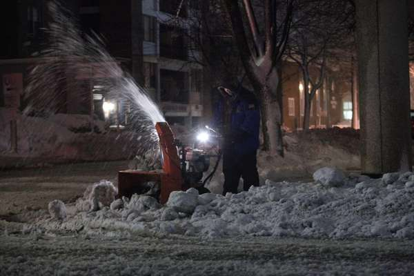 David Colon uses his snowblower to clear a